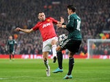 Manchester United's Ryan Giggs and Real Madrid's Mesut Ozil battle for the ball on March 5, 2013