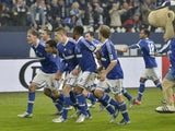 Schalke players celebrate following their 2-1 victory over Borussia Dortmund on March 9, 2013