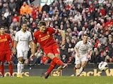 Steven Gerrard slots home a penalty and his team's third against Spurs on March 10, 2013
