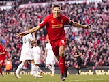 Steven Gerrard celebrates scoring a penalty and the winner against Spurs on March 10, 2013
