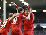 Stewart Downing is congratulated by team mate Luis Suarez after scoring his team's second against Spurs on March 10, 2013