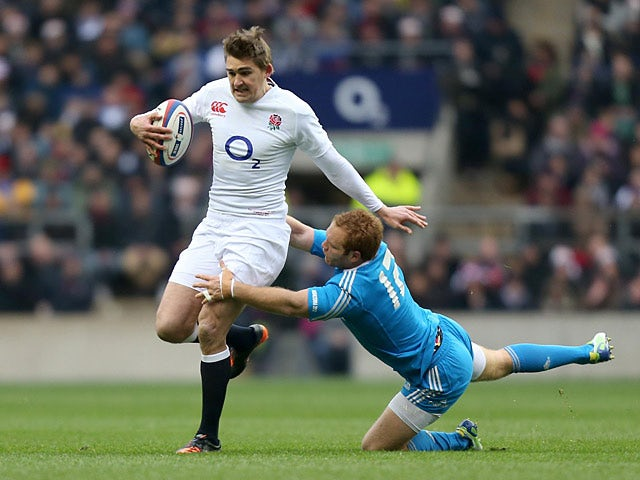 England's Toby Flood is tackled by Italy's Gonzalo Garcia on March 10, 2013