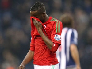 Swansea City's Roland Lamah looks dejected after his side's defeat to West Brom on March 9, 2013