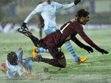 Torino's Alessio Cerci slips in horrendous conditions during the game with Lazio on March 17, 2013