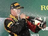 Lotus driver Kimi Raikkonen celebrates with champagne after winning the Australian Formula One Grand Prix on March 17, 2013