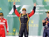 Lotus driver Kimi Raikkonen on the podium after winning the Australian Formula One Grand Prix on March 17, 2013