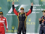Lotus driver Kimi Raikkonen on the podium after winning the Australian Formula One Grand Prix on March 17, 2013
