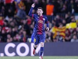 Barcelona's forward Lionel Messi celebrates scoring against AC Milan in the Champions League last 16 clash on March 12, 2013