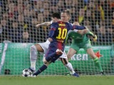 Barcelona's forward Lionel Messi scores his second goal during the second leg of his side's Champions League last 16 match with AC Milan on March 12, 2013