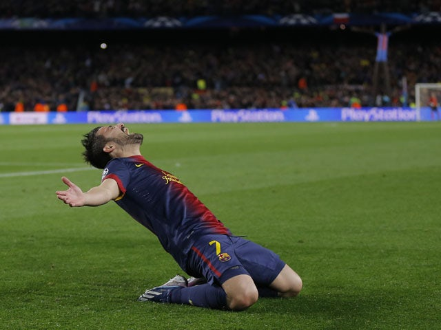 Barcelona's David Villa celebrates after scoring his side's third goal in their Champions League clash with AC Milan on March 12, 2013