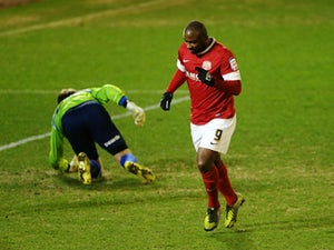 Barnsley's Jason Scotland celebrates scoring against Brighton in the Championship clash on March 12, 2013