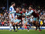 Burnley's Jason Shackell celebrates scoring against Blackburn in the Championship match on March 17, 2013