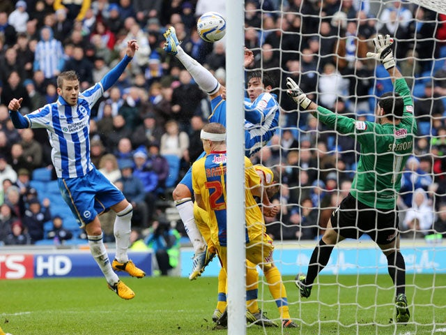 Brighton's Leonardo Ulloa leaps to score his side's first goal in their clash with Crystal Palace on March 17, 2013
