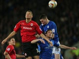 Cardiff City's Ben Nugent wins header beating Leicester City pair Andy King and Michael Keane during the Championship clash on March 12, 2013