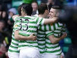 Celtic players celebrate after Kris Commons' goal against Aberdeen on March 16, 2013