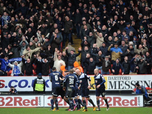 Millwall players celebrate following the second goal in their match against Charlton Athletic on March 16, 2013