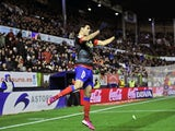 Atletico Madrid's Diego Costa celebrates a goal against Osasuna on March 17, 2013
