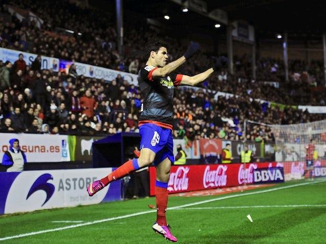 Atletico Madrid's Diego Costa celebrates a goal against Osasuna on March 17, 2013