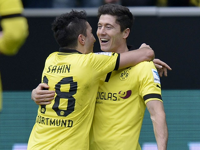 Borussia Dortmund's Robert Lewandowski celebrates scoring his second goal during his side's match against Freiburg on March 16, 2013