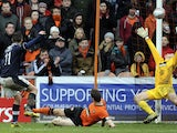 Dundee's Ryan Conroy scores during the Scottish Premier League match against Dundee United on March 17, 2013