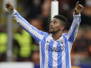 Malaga midfielder Eliseu celebrates scoring against AC Milan on November 6, 2012