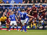 Everton's Darren Gibson takes a free-kick during his side's Premier League clash with Manchester City on March 16, 2013