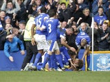 Everton players celebrate after Nikica Jelavic scored his side's second goal in their Premier League clash with Manchester City on March 16, 2013