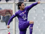 Fiorentina's Alberto Aquilani jumps in celebration after scoring against Genoa on March 17, 2013