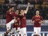 Roma captain Francesco Totti celebrates a goal against Parma on March 17, 2013