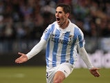 Malaga's Isco Alarcon celebrates after scoring the opening goal against Porto on March 13, 2013