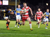 Wigan Warriors Liam Farrell runs clear to score a try during the Super League match against Leeds Rhinos on March 15, 2013
