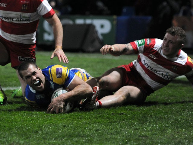 Leeds Rhinos' Joel Moon scores a try during the Super League match against Wigan Warriors on March 15, 2013