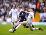 Leeds United's Samuel Byram slides in on Huddersfield Town's Paul Dixon during the Campionship clash on March 16, 2013