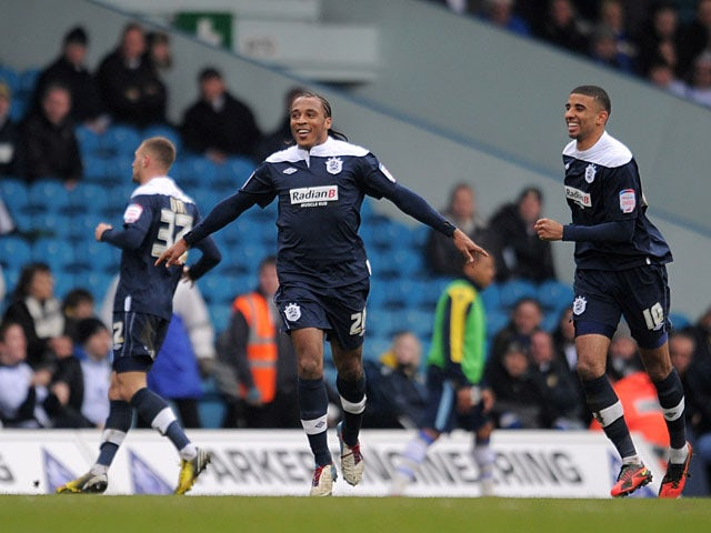 Huddersfield Town's Neil Danns celebrates after scoring his team's opening goal in their Championship clash with Leeds United on March 16, 2013