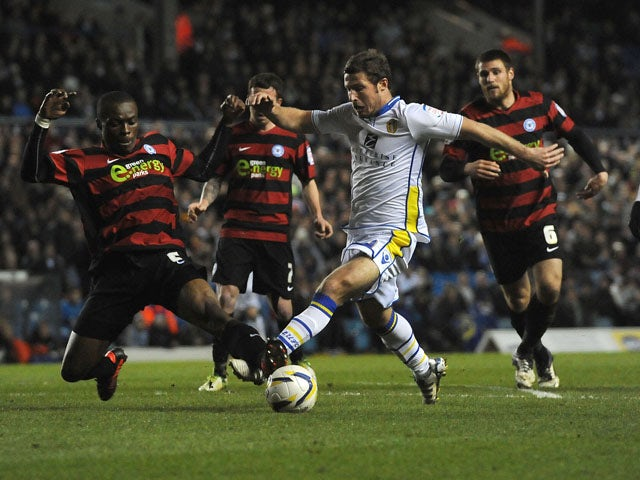 Leeds United's David Norris and Peterborough United's Gabriel Zakuani battle for the ball during the Championship match on March 12, 2013