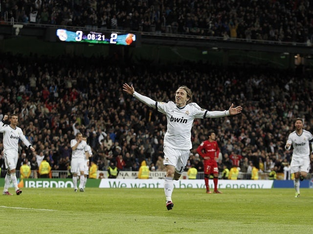 Real Madrid's Luka Modric celebrates a goal against Mallorca on March 16, 2013