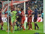 Bayern goalkeeper holds onto the ball after Arsenal's Laurent Koscielny headed in his team's second on March 13, 2013