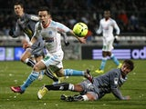Marseille's midfielder Mathieu Valbuena challenges for the ball with Ajaccio's Mehdi Mostefa on March 15, 2013