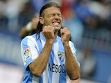 Malaga's Martin Demichelis celebrates during a game with Valencia on April 29, 2012