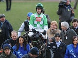Wayne Hutchinson celebrate on Medinas after winning the Coral Cup at the 2013 Cheltenham Festival on March 13, 2013