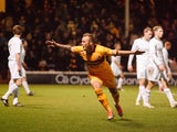 Motherwell's Kallum Higginbotham celebrates scoring the third goal against Hibernian on March 15, 2013