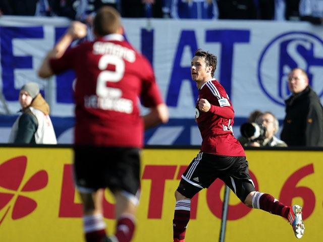 Nuremberg's Markus Feulner celebrates after scoring against Schalke on March 16, 2013