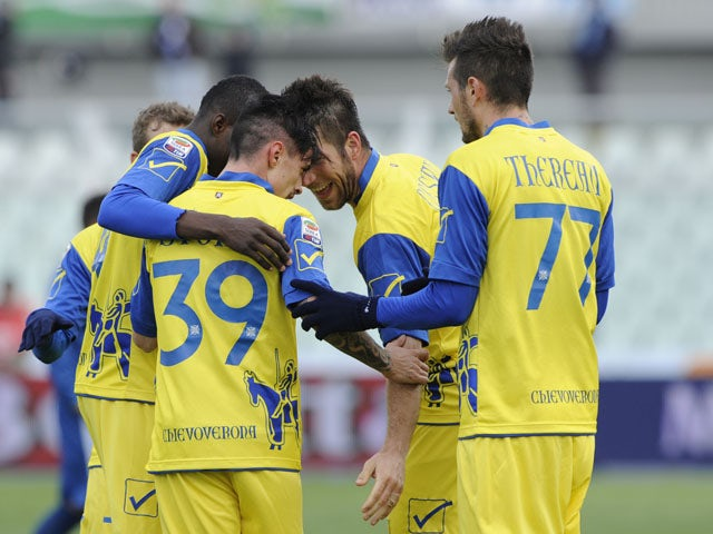 Chievo players celebrate following Adrian Marius Stoian's goal in their game against Pescara on March 17, 2013