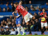 Manchester United's Rio Ferdinand battles for the ball with Chelsea's Fernando Torres on October 28, 2012