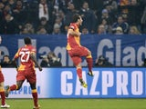 Galatasaray's Hamit Altintop celebrates scoring his side's first goal of the night in their Champions League tie with Schalke on March 12, 2013