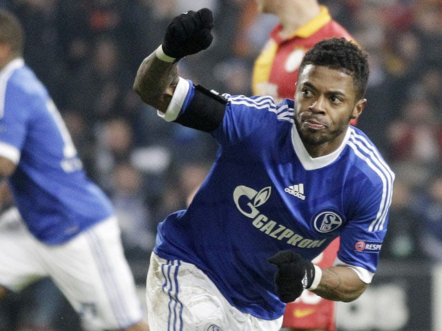 Schalke's Michel Bastos celebrates scoring his side's second goal in their match with Galatasaray on March 12, 2013