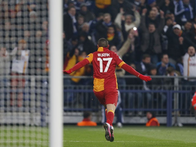 Galatasaray's Burak Yilmaz celebrates scoring his side's second goal against Schalke on March 12, 2013