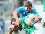 Italy's Simone Favaro tries to tackle Ireland's Peter O' Mahony during their Six Nations match on March 16, 2013