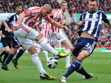 Stoke City's Jon Walters sees his shot blocked by West Bromwich Albion's Gareth McAuley during the Premier League match on March 16, 2013