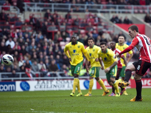 Sunderland's Craig Gardner scores a penalty during his side's match against Norwich on March 17, 2013